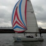 Skipper Grant expertly guiding Mei Li up the Snohomish River in Everett after a Sunday race. Under spinnaker no less!