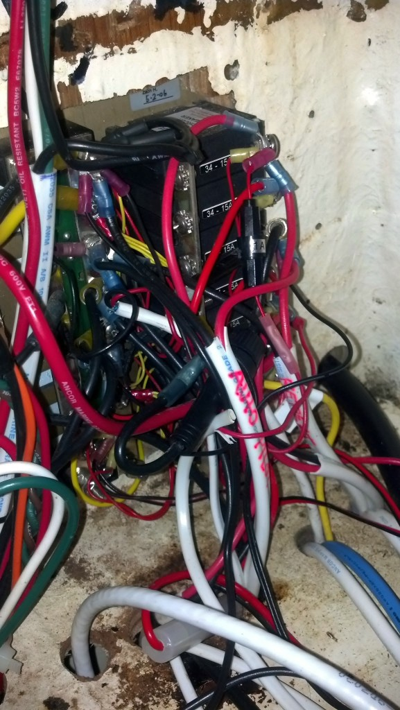 Wired in to the auxiliary panel. What a mess!