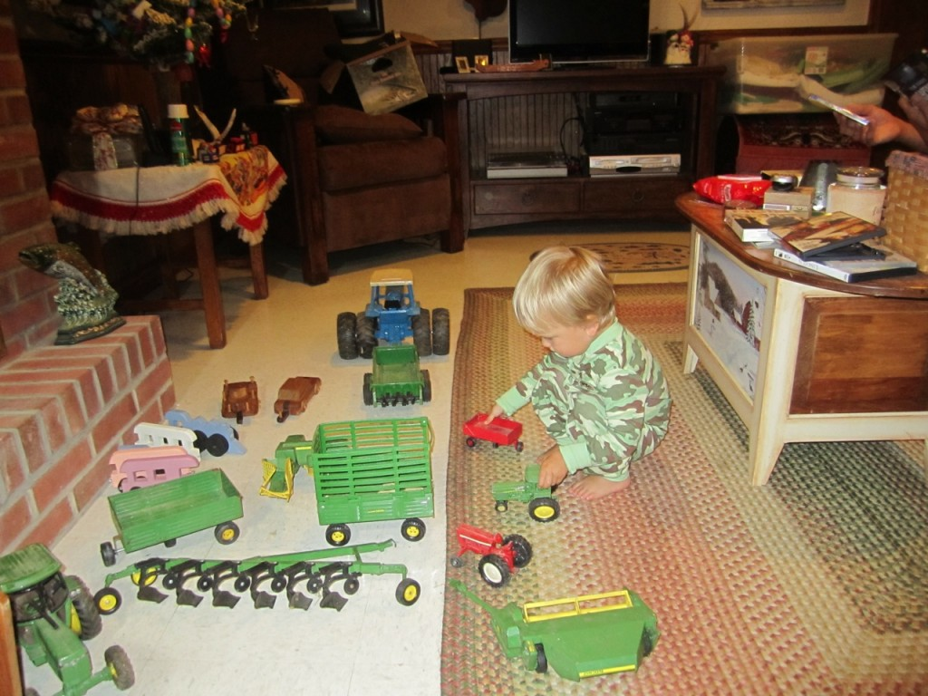 "Playing with big tractors in the basement. Sully calls tractors ""gowa"""