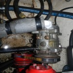 The fridge compressor is run off a belt from the engine