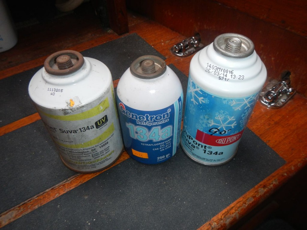 Three very different cans of refrigerant, but they're all 134Ae kind we need