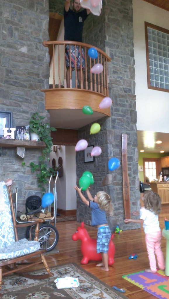 We had a bag of balloons in the camper from Sully's birthday in Tampa. Why not make it rain balloons in the great room for the kiddos?