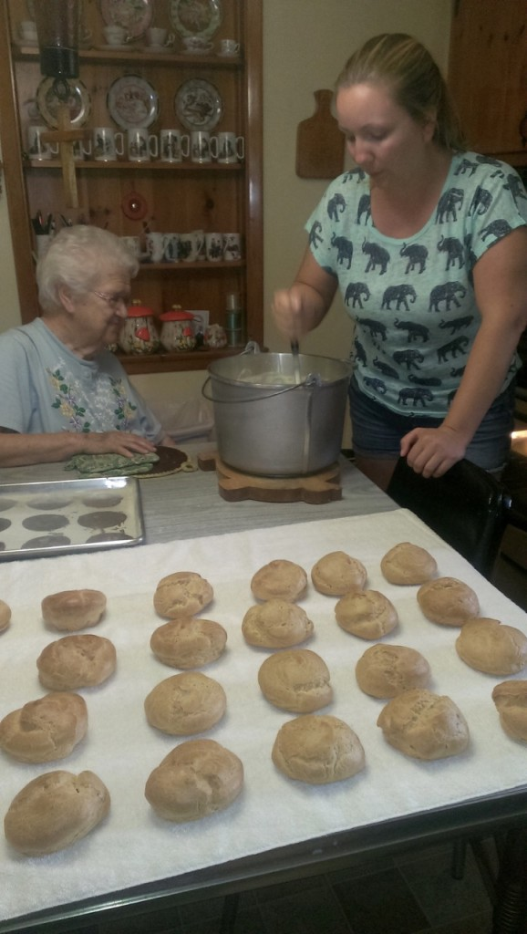 Over two dozen cream puff shells cooling