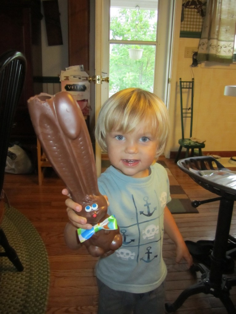 Sully started eating his Easter bunny from Nana by biting in to the huge ears