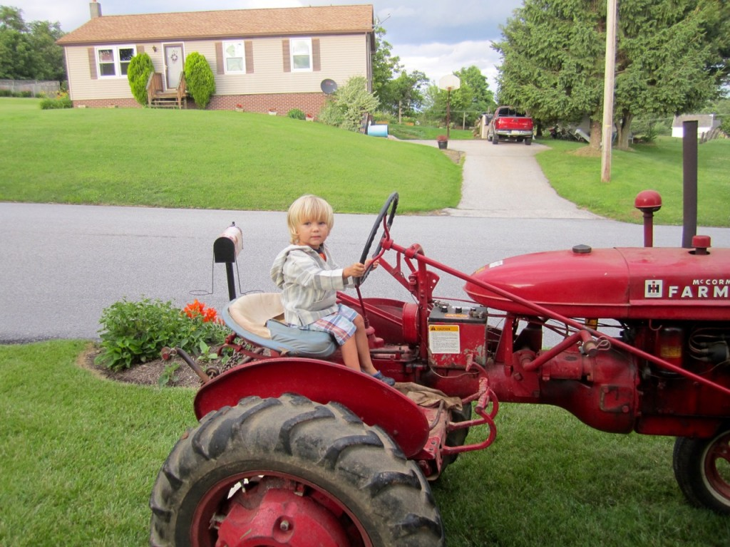 Tractor sitting in the front yard