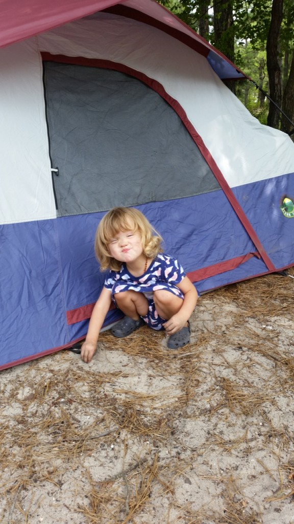 Elena playing outside her tent