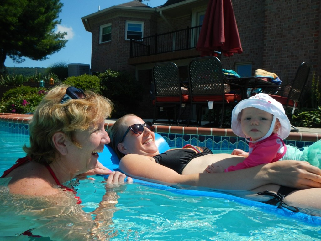 Vera floating around with Meme and her Mommy