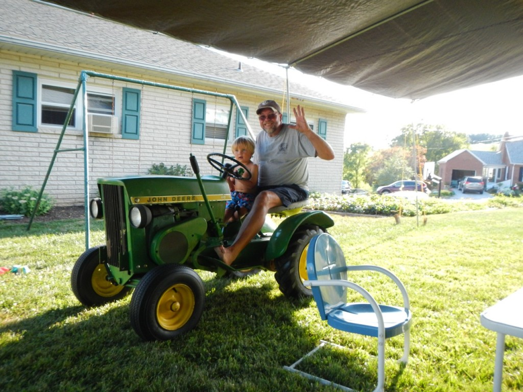 Sully and Pappy rode the tractor up to help take down the party tarp