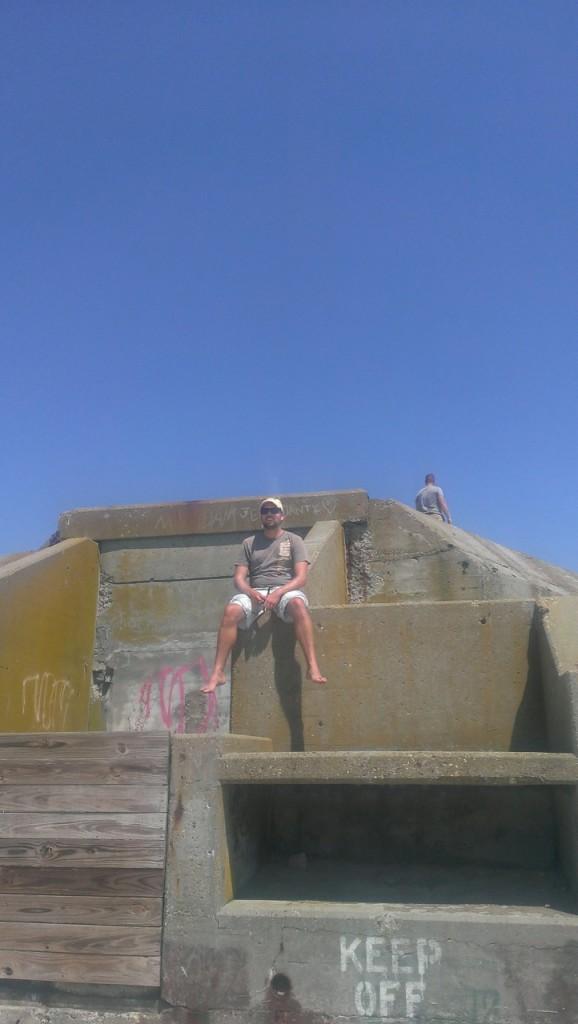 Climbing on an abandoned gun turret on the beach near Cape May, NJ
